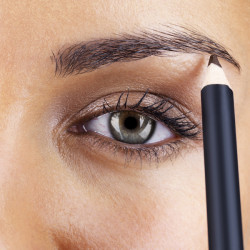 Cropped image of a young female darkening her eyebrows with eyeliner