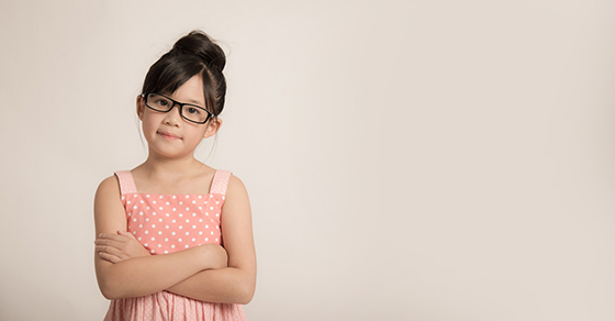 Young Child In Glasses